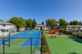 Basketball Court On-site with playground right next to it.