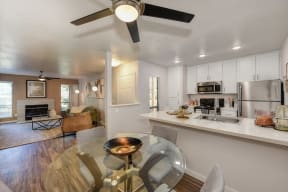 Kitchen Dining Area, Living Room, Hardwood Inspired Floor, Ceiling Fan/Light and Fireplace