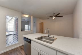 Kitchen with Dishwasher, Sink, Window and View of Dining Area