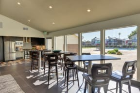 Leasing Office Dining Area, Hardwood Inspired Floors, Stool Seats, Tables, Full Windows with View of Pool, Fridge, Oven, Wood Cupboards