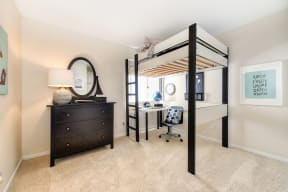Bedroom with Bunk Bed, Carpet, White Desk, Black Dresser and Window