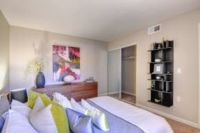 Large Bedroom with Closet Storage Space, Carpet, Black Shelves, Wood Dresser, Abstract Mural