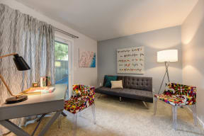 Guest Bedroom with Gray Sofa, Colorful Chairs, Gray Desk and View of Sliding Patio Door