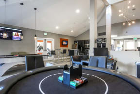 Office with Poker Table, Flat Screen Television, Pool Table, Exit Sign and Black Cabinents