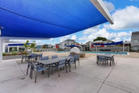 Pool and Seating Area, Blue Sun Cover, Tables, Blue Seats, Blue Skies and Clouds
