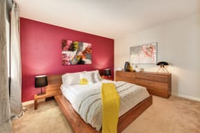 Red Wall Bedroom with Full Sized Mattress and Wooden Frame, White Comforter and Yellow Blanket, Wood Dresser, Abstract Painting