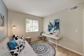 Spare Bedroom with Desk, painting and window with Black/White designed Rug