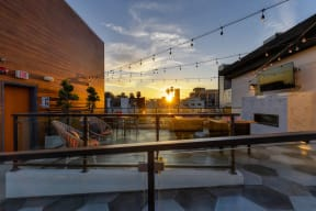 Rooftop lounge area at sunset with views of Hollywood