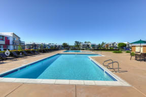 Swimming Pool Outside Community Space with Lounge Chairs, Gate, Apartment Exteriors