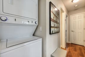 Washer Dryer with Wood Inspired Floor, White Doors, Ceiling Lights