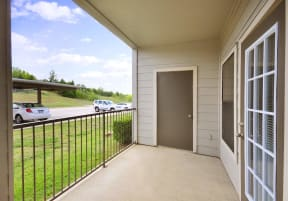 Covered Patio with Storage Facility at Stoneleigh on Cartwright Apartments, J Street Property Services, Mesquite,Texas