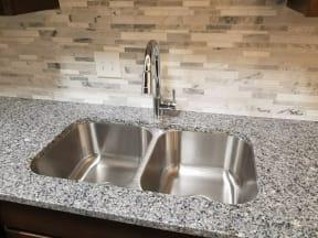 Under mount Sink, Goose Neck Faucet, Granite Top, and Back-splash