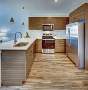 kitchen with a sink and silver appliances at Brixton South Shore, Austin, Texas