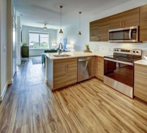 kitchen appliances with brown cabinets at Brixton South Shore, Austin, 78741
