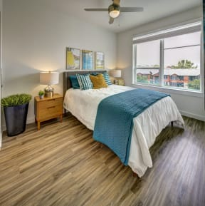 bedroom with green and white comforter at Brixton South Shore, Austin, 78741