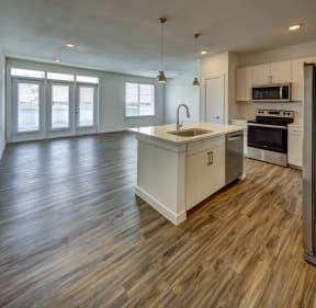 kitchen with a view of living room at Brixton South Shore, Austin, TX, 78741