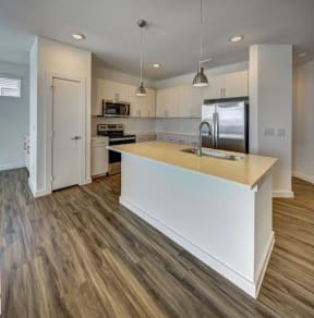 kitchen with an island at Brixton South Shore, Austin, TX, 78741