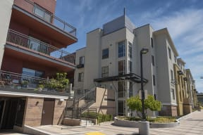 Exterior building view with entry to building balconies