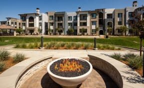 Downtown Sacramento CA Apartments-The Core Natomas Apartment Exterior with Lush Landscaping and Street Parking