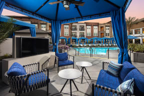 Media area near pool with outdoor seating