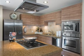 Apartments for Rent in Irvine, CA - Astoria at Central Park West Kitchen With Stainless Steel Appliances, Granite Countertops and Modern Finishes