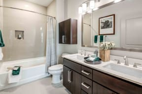 Apartments in Chandler AZ for Rent-The Core Chandler Bathroom with Large Bathtub and Spacious Vanity Area with Double Sinks