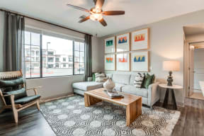 Pet Friendly Apartments in Chandler AZ-The Core Chandler Open Living Room with Large Window with a Great View, Wood Style Floors, and a Refreshing Ceiling Fan