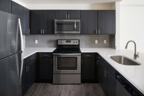 Espresso Cabinetry and White Countertops at The Manhattan Tower and Lofts, 1801 Bassett Street, Denver