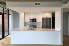 Apartments with contemporary open floor plans at IO Piazza by Windsor, 2727 South Quincy Street, Arlington