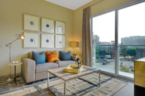 Large windows with views of Downtown LA from Living Room at South Park by Windsor, 90015, CA