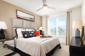 Large bedroom windows with stunning views at Metro West, 8055 Windrose Ave, TX
