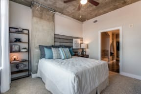 Expansive bedrooms with plush carpeting and ceiling fans