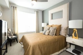 Spacious bedroom accommodates king-sized beds at Metro West, Plano, Texas