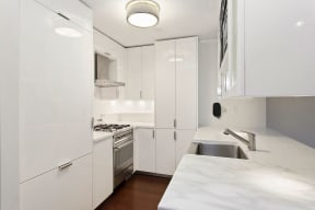 Designer kitchen with white lacquer at The Aldyn, NY, 10069