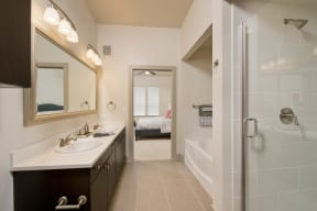 Large Soaking Tub In Bathroom With Tile Surround at Windsor at West University, Houston, 77005