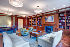 Club Room With Large Screen Tvs And A Fireplace at The Woodley, 2700 Woodley Road, NW, Washington, DC