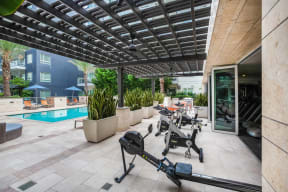 Outdoor Spin Bikes With A Pool View at South Park by Windsor, 939 South Hill Street, Los Angeles