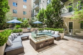 Poolside Fire Pit at Windsor at South Park by Windsor, Los Angeles, 90015