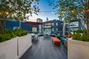 Rooftop Deck with Lounge and Dining Area at Windsor at West University, Houston, Texas