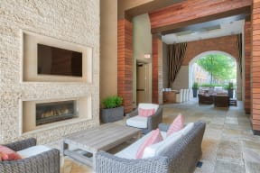Outdoor Lounge With Fireplace And Television at Windsor at Cambridge Park, 02140, MA