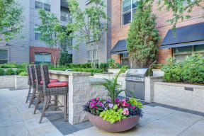 Resident Courtyard With Grilling Area at Windsor at Cambridge Park, Cambridge, MA