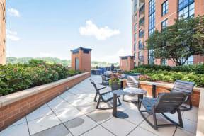 Outdoor, landscaped terrace at IO Piazza by Windsor, Arlington, Virginia