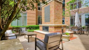 One of Five Courtyards With BBQ Grills at Crescent at Fells Point by Windsor, Baltimore, MD