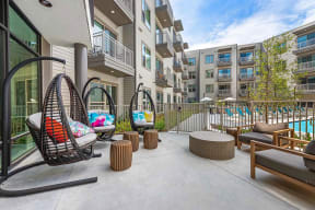 Lounge area near pool at Windsor Preston, Plano, Texas