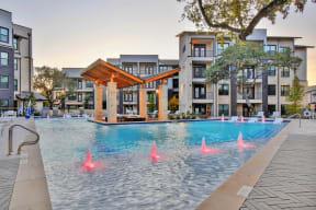The resort style pool lit up at night at Windsor Ridge, Austin, TX