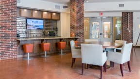 Entertain friends in the Eleven Lounge with a game of pool or shuffleboard at Eleven by Windsor, Austin