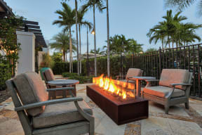 Outdoor lounges allow you to enjoy the Florida weather throughout the year at Windsor at Delray Beach, Florida
