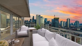 Outdoor space and city views at Flair Tower Apartments, IL, 60654