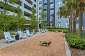 Corn hole boards and playing space at Metro West, 8055 Windrose Ave, TX