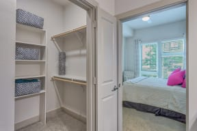 Walk-in closets with custom shelving at Metro West, Plano, TX